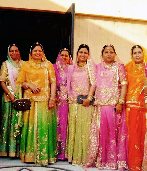 Rukhmani founders, Vineeta (first from left), Bindu (third from right) and Sunita (second from right) at a family wedding, wearing Rukhmani Poshaks