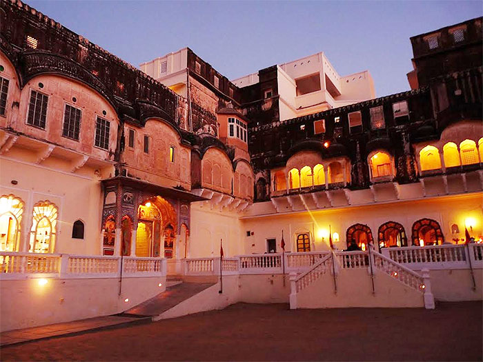 The lighted façade of the Mandawa fort in the evening is imposing in its grandeur, paying homage to the past but encapsulating today's comforts