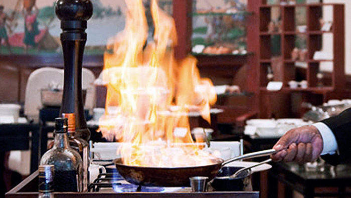 RETRO REVIVAL | The art of flambé is a vintage culinary technique and is practiced with élan at Nostalgia, making the food a sight to feast on