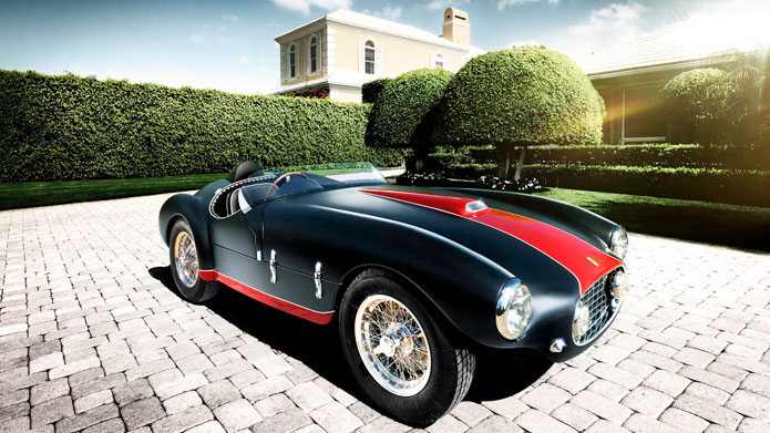 A TIMELESS TALE | The black and red matte finish along with the clean lines of the automobile's construction are in perfect harmony with the manicured gardens where the photograph was shot