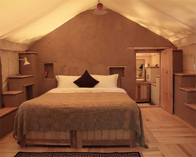 HAUTE HERITAGE | The five lavish tents scattered across the orchard have reading rooms and bedrooms with attached bathrooms