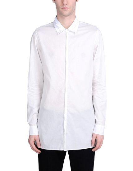 ANN DEMEULEMEESTER | Taking a casual but more structured route will be this plain woven long white shirt with collar detailing from the namesake brand