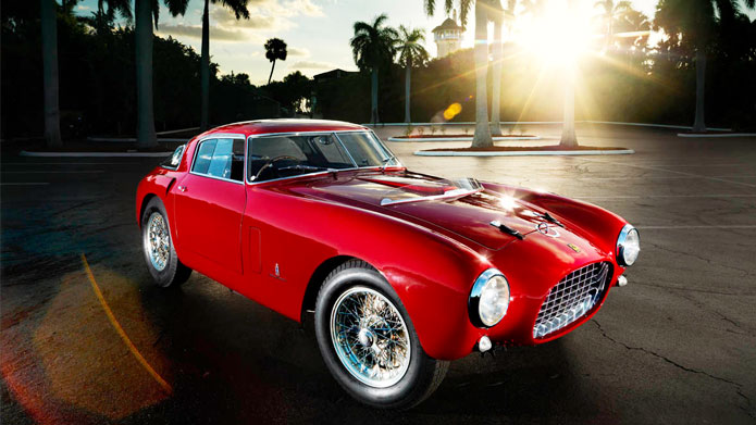 RED HAUTE | A vintage Ferrari, in red color. A Tropical climate with majestic palm trees around. Life certainly doesn't get any better than this!