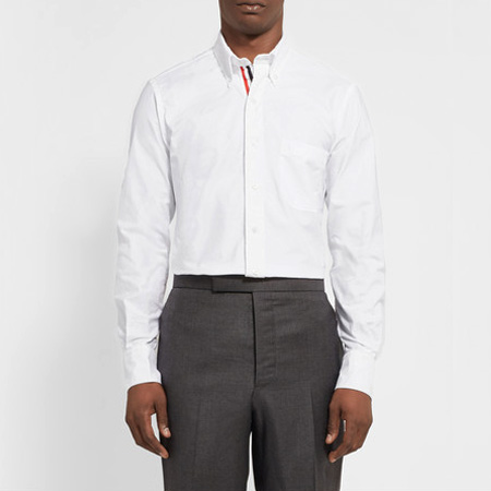 THOM BROWNE | Channel in effortless American cool with the Thom Browne white shirt over sharp trousers