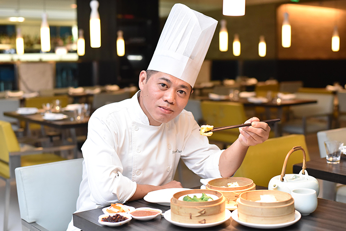 CHEF AT WORK | Chef Stanley LumWahCheok, the Head Chef for Yauatcha India, enjoys his favourite steamed dim sums with prawn or pork filling