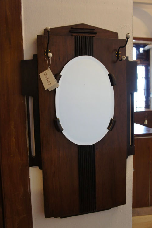 IF LUXE COULD KILL | Admiring yourself got a new dimension with this art deco mirror, complete with coathooks, from Camelot