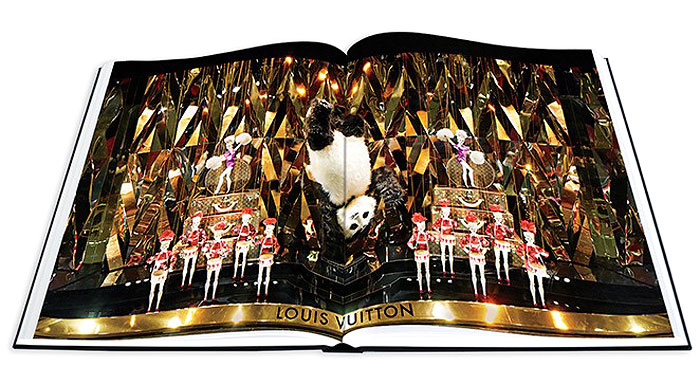 VUITTON VANITY | The 168-page art series highlights windows filled with roller coasters, circus performances and golden dinosaurs built around the label's offerings