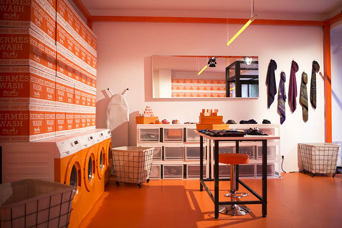 HERMESMATIC POP UP |Innovatively designed as a Laundromat, this store in Munich offered a whole range of Hermès classics silk creations like the scarves, mini bowties, twillys