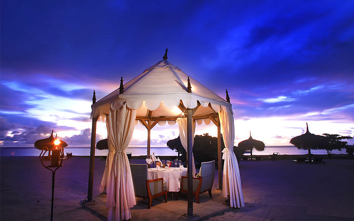 MARADIVA VILLA RESORT | Love takes on a new meaning as this private beach tent becomes the castle for two, under the ink-blue Mauritian sky, accompanied by some delectable world class cuisine