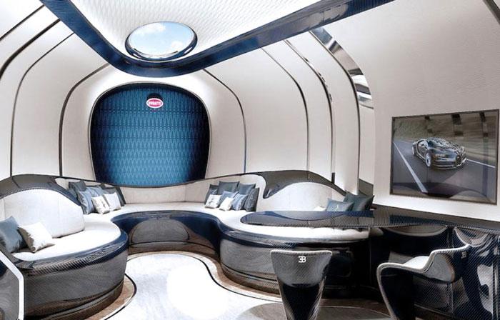 A signature Bugatti horseshoe shaped salon features heritage automotive traits, including the macaron skylight