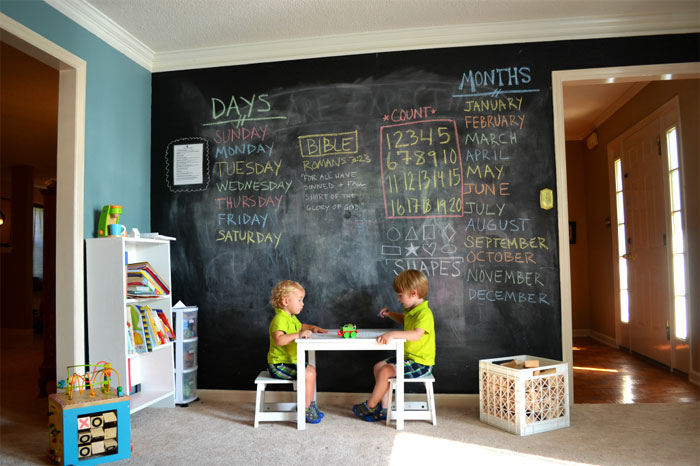 Painting the entire wall in chalkboard paint is a great investment since the kids can get creative with it