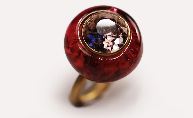 Faceted spinel and carved tourmaline ring