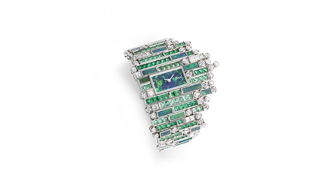 Verde Bisazza watch takes the shape of waves rippling at the shore with a mosaic of emeralds, diamonds and green tourmalines